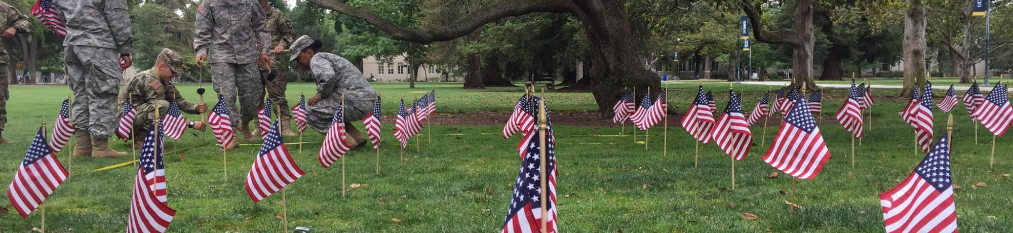 Students placing flags on the quad
